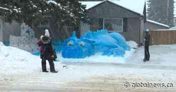 Huge blue snow dragon providing photo-op joy to Saskatoon residents