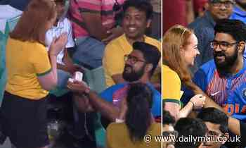 Indian cricket fan proposes to his Australian girlfriend in the crowd as their teams go head-to-head