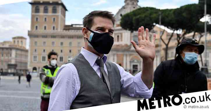 Tom Cruise takes no chances as he doubles up on face masks while greeting fans on set of Mission: Impossible 7