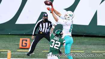 Dolphins lead Jets 13-3 at half