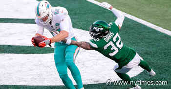 Ryan Fitzpatrick Throws Two Touchdowns as Dolphins Beat the Jets