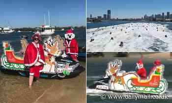 Santas ditch their sleighs for JET SKIS as 150 gather on the Gold Coast to break a world record