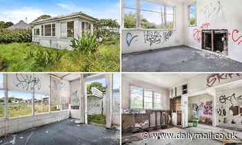 South Auckland dump of a house with holes in the walls, graffiti and weeds could sell for $1million