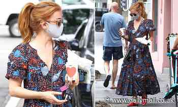 Isla Fisher grabs a coffee in Sydney after dropping her children off at school