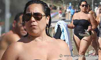 Beating the heat: Kate Ceberano joins hundreds of Sydneysiders at Bronte Beach