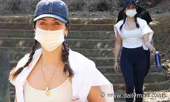 Ana de Armas styles her hair in braids as she enjoys a midday hike with a female pal