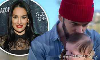 Nikki Bella shares photo of fiance Artem Chigvintsev kissing baby boy as they plan couples therapy