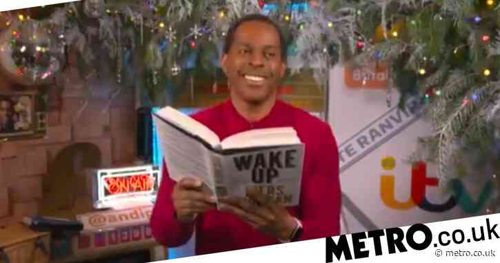 Andi Peters kicks Piers Morgan's book across the room as they awkwardly clash over awards