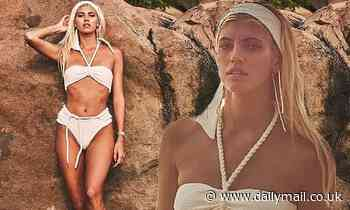 Devon Windsor sends temperatures soaring as she struts her stuff in flirty white bikini