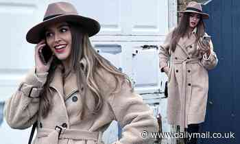 TOWIE's Chloe Ross cuts a chic figure in a fluffy coat and fedora hat