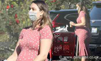 A heavily pregnant April Love Geary shows off her baby bump in a red polka dot dress at Target