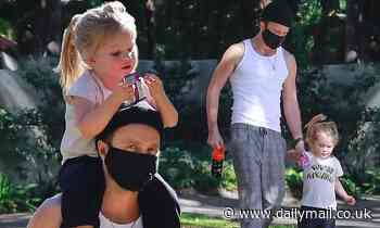 Aaron Paul is a doting dadas he carries daughter Story on his shoulders during bonding outing in LA