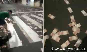 Brazilian bank robbers leave cash strewn across the streets to aid their getaway