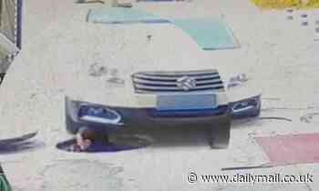 Sewer worker survives after being run over ON THE HEAD by a passing car in China
