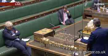 Boris Johnson's awkward body language as  Starmer tears into Covid tiers plan