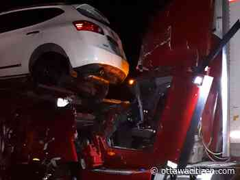 Firefighters free trucker after crash with car carrier leaves vehicle on truck's roof