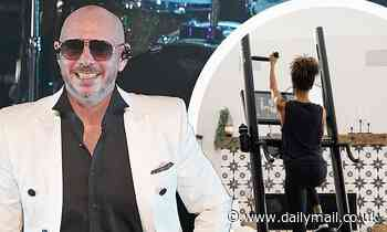 Pitbull gives equipment to SLAM! charter school chain he helped start as he invests in CLMBR