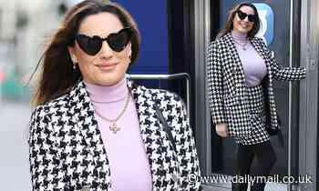 Kelly Brook is effortlessly chic in a houndstooth skirt suit as she arrives to work at Heart FM