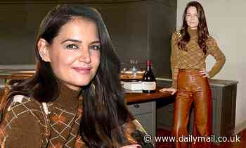 Katie Holmes is seasonally stylish as she plays up her legs in leather burnt-orange trousers