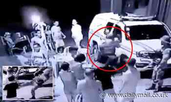 Shocking moment cop shot man in the leg while attempting to break up cafe gathering