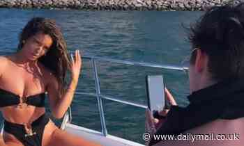 Love Island's Chris Taylor takes photos of girlfriend Maura Higgins in her swimwear