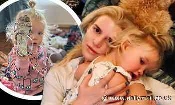 Jessica Simpson cuddles up to 20-month-old daughter Birdie Mae as she bonds with her youngest
