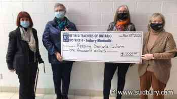 Retired teachers group donates $1,000 to Keeping Seniors Warm program