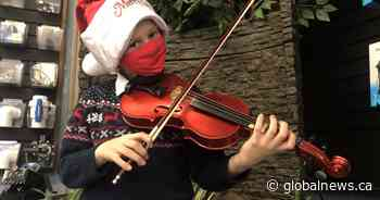 Fiddle for a cause: 8-year-old fiddler donates hundreds of dollars in busking tips to charities