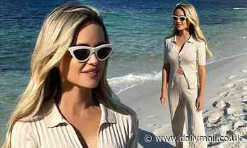 AFL WAG Jessie Murphy flaunts her slender figure in a rather conservative beach outfit