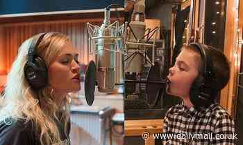Carrie Underwood shares first snap of Little Drummer Boy duet with son Isaiah, 5, from Xmas special