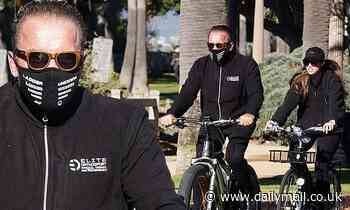 Arnold Schwarzenegger and daughter Christina match in black while riding bikes in LA