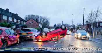 Driver flees scene after car ends up on its roof in Salford - Manchester Evening News