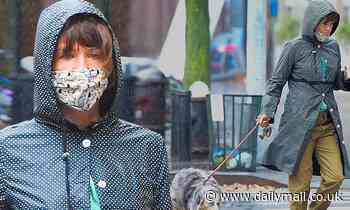 Helena Christensen steps out in a hypnotic polka-dot raincoat as she walks her dog Kuma in the rain