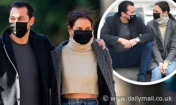 Katie Holmes looks ready for winter as she strolls arm-in-arm with her beau Emilio Vitolo Jr.