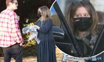 Ashley Tisdale covers up her baby bump in flowing dress as she gets her Christmas tree shopping done