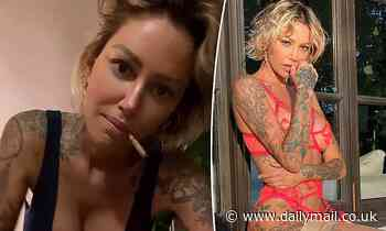 Tina Louise, 39, flaunts ample assets as she puffs on a joint while dancing at home