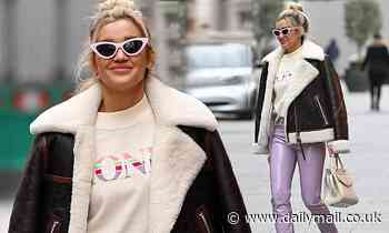 Ashley Roberts wears lilac PVC trousers and slogan T-shirt
