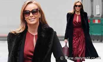 Amanda Holden cuts a glamorous figure in a maroon dress and smart black coat as she leaves Heart FM