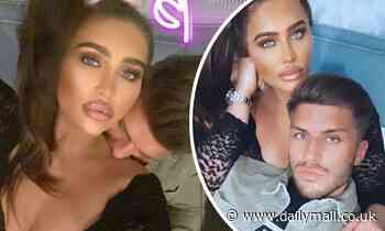 Lauren Goodger puts on a busty display as she's nuzzled on the neck by boyfriend Charles Drury