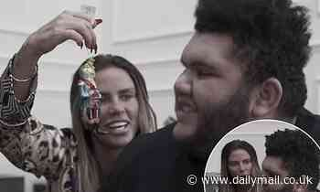 Katie Price's son Harvey is delighted as she surprises him with frog and train Christmas decorations