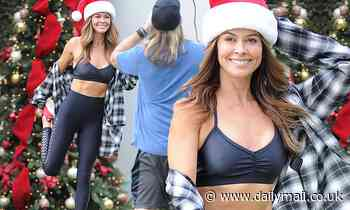 Brooke Burke shows off sculpted abs in a bra top as she works up a sweat