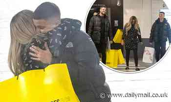 Katie Price hugs son Junior as she attempts to walk again during family shopping trip