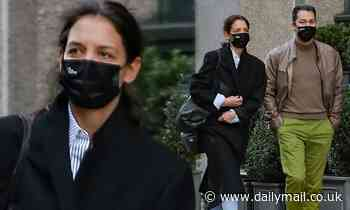 Katie Holmes takes on winter in NYC as she enjoys a romantic stroll with boyfriend Emilio Vitolo Jr