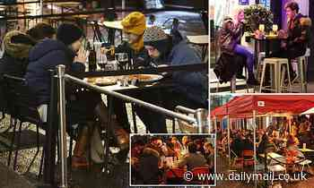 Pub-goers wrap up in scarves and woolly hats