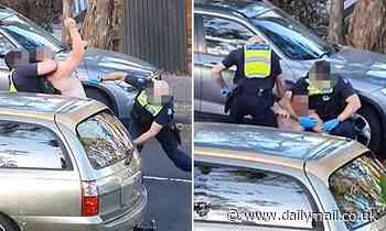 Astonishing moment a shirtless man is DRAGGED out of his car by cops in front of a woman's house