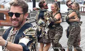 Hugh Sheridan beams as he dances at pal Camilla Franks' extravagant boat party in Sydney.