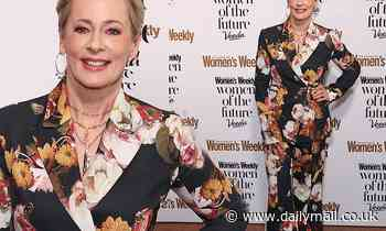Amanda Keller, 58, goes arthouse chic in a tailored floral suit for Women of the Future Awards
