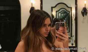 April Love Geary highlights her growing baby bump while posing in the nude