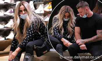 Katie Price, 42, buys a collection of designer shoes with boyfriend Carl Woods, 31