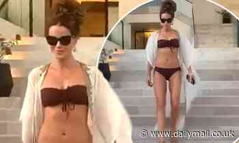 Kate Beckinsale, 47, shows off her age-defying physique in a maroon bikini